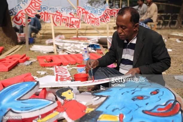 An artist paints on cork sheet at Suhrawardy Udyan ahead Ekushey Book fair in Dhaka Bangladesh on January 28 2019 Countrys biggest literary Book...