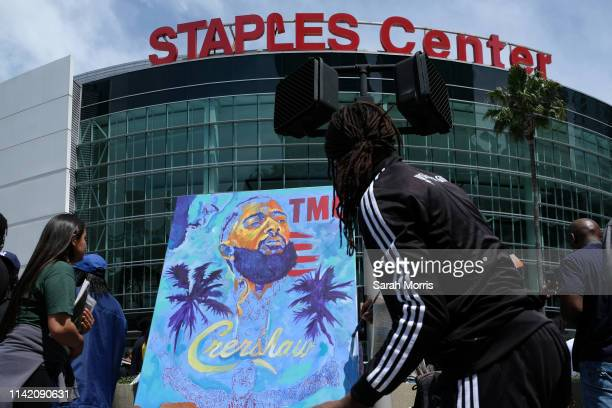 An artist paints outside of Staples Center during hip hop artist and community activist Nipsey Hussle's Celebration of Life ceremony on April 11 2019...