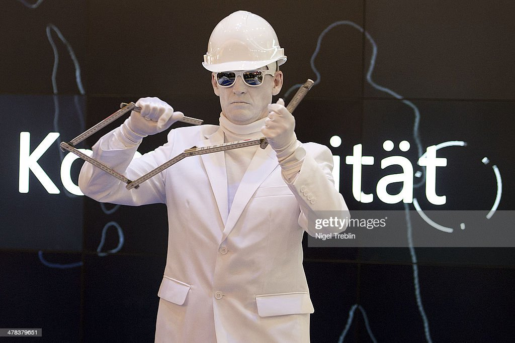 An artist peforms with a folding rule at the Microsoft stand at the 2014 CeBIT technology Trade fair on March 13, 2014 in Hanover, Germany. CeBIT is the world's largest technology fair and this year's partner nation is Great Britain.