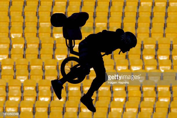 An artist performs a stunt on a tricycle during Nitro Circus Live at Westpac Stadium on February 9 2013 in Wellington New Zealand