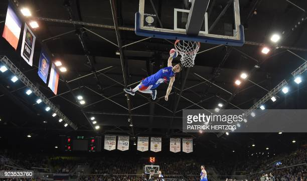 An artist performs at half-time, during the FIBA Basketball World Cup 2019 qualifier between France and Russia at the Rhenus Hall in Strasbourg,...