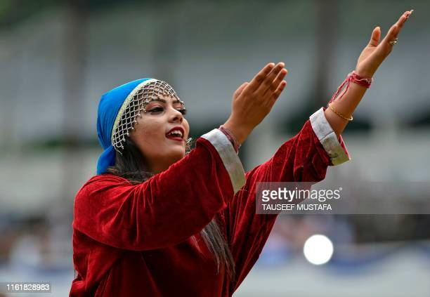 An artist performs during a cultural event during a ceremony to celebrate India's 73rd Independence Day which marks the end of British colonial rule...