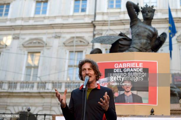 An artist performs during a rally to demand the release of the Italian journalist blogger writer and human rights activist Gabriele Del Grande that...