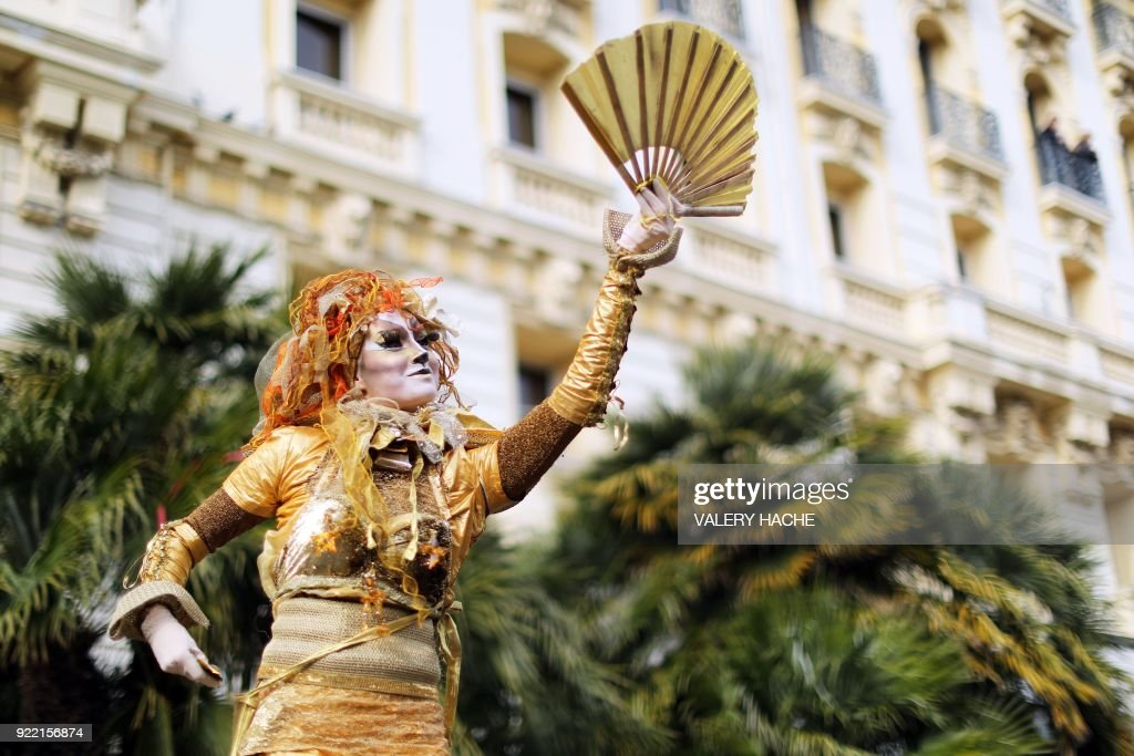 An artist performs during the 134th edition of the Nice Carnival on February 21, 2018 in Nice. The theme of this year's edition, which runs from February 17 until March 3, is the 'King of Space'. /