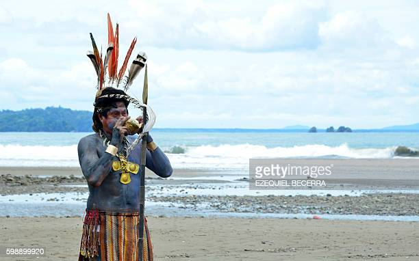 An artist performs during the 8th Annual Whale and Dolphin Festival at Bahia Ballena Beach in Puntarenas about 230 km southwest of San Jose on...