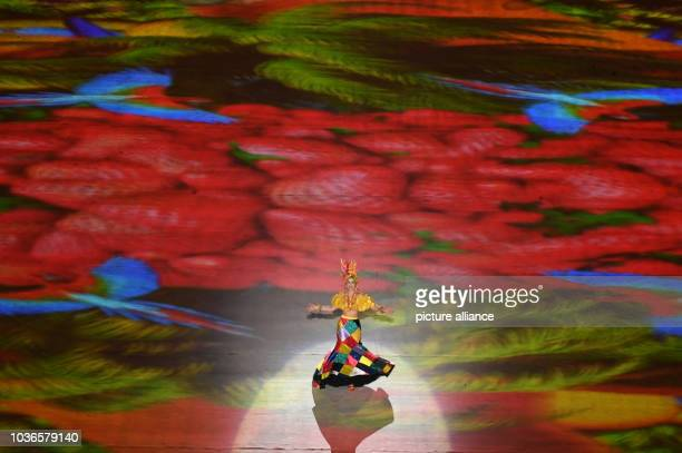 An artist performs during the Closing Ceremony of the Rio 2016 Olympic Games at Maracana in Rio de Janeiro, Brazil, 21 August 2016. Photo: Sebastian...
