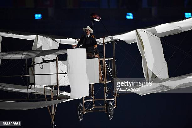 An artist performs in an aircraft during the opening ceremony of the Rio 2016 Olympic Games at the Maracana stadium in Rio de Janeiro on August 5...
