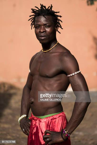 An artist poses for a portrait ahead of the Bissau Carnival parade on February 12 2018 in Bissau The 2018 edition of the Bissau Carnival celebrating...