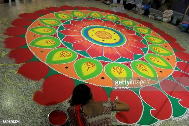An artist prepares Rangoli ahead of the auspicious occasion of Diwali in Delhi on October 12 2017