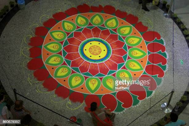 An artist prepares Rangoli ahead of the auspicious occasion of Diwali in Delhi on October 12 2017