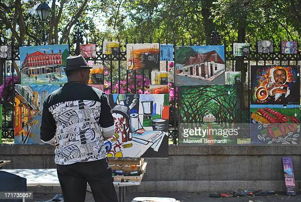 An artist sells his work in the French Quarter of New Orleans, LA on a beautiful spring day.