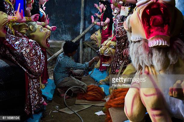An artist spray paints idol of lion for upcoming Durga festival Today is the most auspicious time is here Today being the very first day of the...