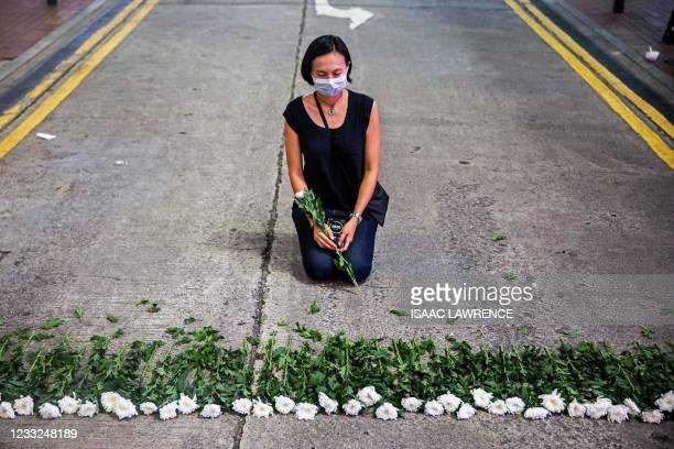 An artist takes part in a performance art in the Causeway Bay district of Hong Kong on June 3 to mourn the victims of China's deadly Tiananmen Square...