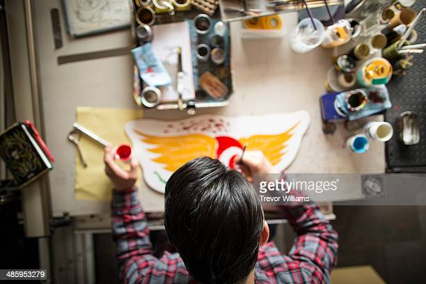 An artist working with a paint brush