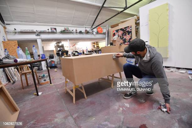 An artist works at LaVallee a 6000 squaremetre coworking space at the heart of the Brussels district of Molenbeek on November 14 2018 The French...
