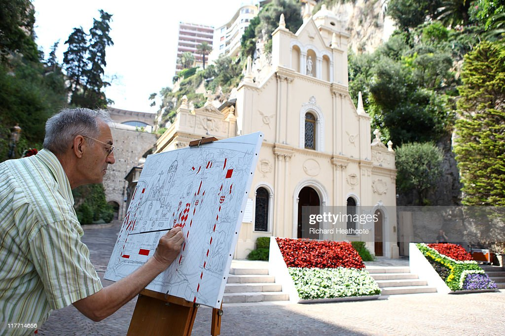 An artist works on a painting outside Sainte Devote church ahead of the Royal Wedding of Prince Albert II of Monaco to Charlene Wittstock on June 30, 2011 in Monaco. The civil ceremony will take place in the Throne Room of the Prince's Palace of Monaco on July 1, followed by a religious ceremony to be conducted in the main courtyard of the Palace on July 2. With her marriage to the head of state of Principality of Monaco, Charlene Wittstock will become Princess consort of Monaco and gain the title, Princess Charlene of Monaco. Celebrations including concerts and firework displays are being held across several days, attended by a guest list of global celebrities and heads of state.
