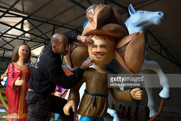 OUT== An artist works on an effigies of Hassan Nasrallah head of Lebanon's militant Shiite Muslim Hezbollah movement and Israeli Economy Minister and...