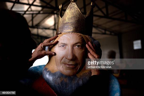 OUT== An artist works on an effigy of Israeli President Benjamin Netanyahu to be used in a parade float during preparations for the Jewish...