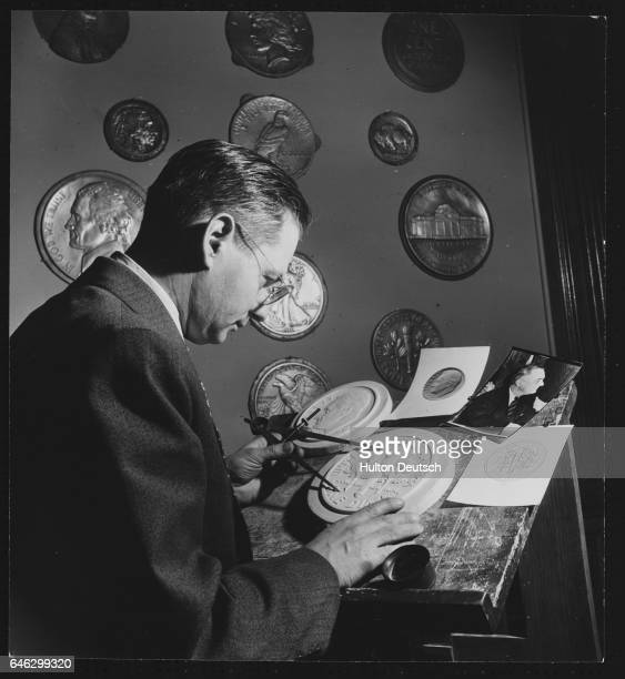 An artist works on the design of dime coin which is to picture the head of the US president Franklin Delano Roosevelt