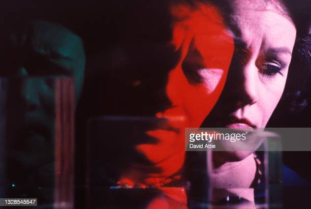 An artistic photo montage of a troubled or stressed-looking woman in January 1969 in New York City, New York.