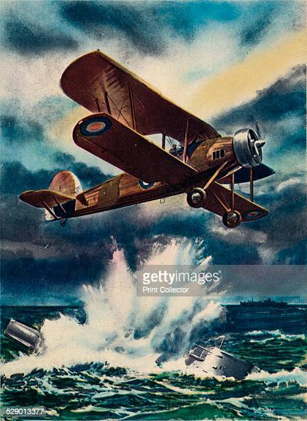 An artist's impression of a Fairey Swordfish sinking a U Boat in the North Sea', 1940. The Fairey Swordfish was a torpedo bomber biplane designed by...