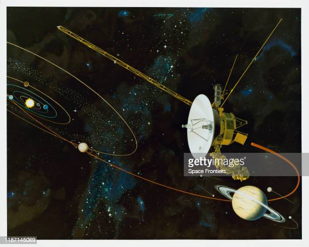 An artist's impression of the Voyager 1 space probe flying past Saturn in the outer solar system circa 1980