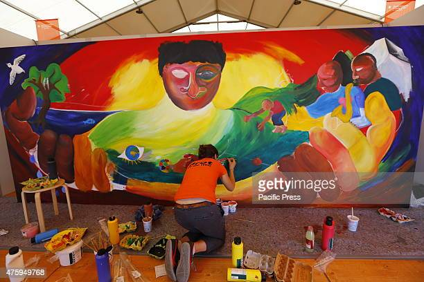 An artists paints a large painting at the 35th German Protestant Church Congress The second and first full day of the 35th Protestant Church Congress...