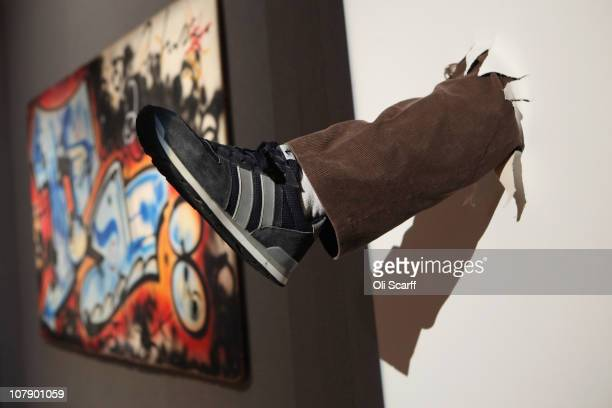 An artwork by artist Mark Jenkins entitled 'Kicked Paintings Series' is displayed in Bonhams auction house on January 6, 2011 in London, England. The...