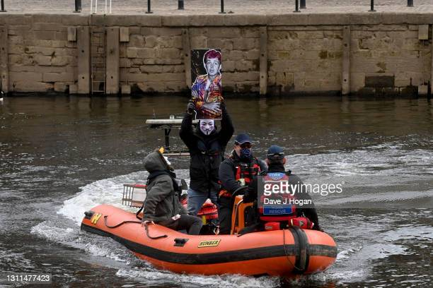 "An artwork featuring an image of Sir Paul McCartney is sailed on the river Ouse by artists The Postman during the ""Guardians Of York"" art unveiling..."