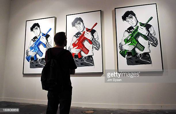 An artwork featuring Elvis Presley by controversial Los Angeles based French pop artist Thierry Guetta aka Mr Brainwash is pictured at the Old...