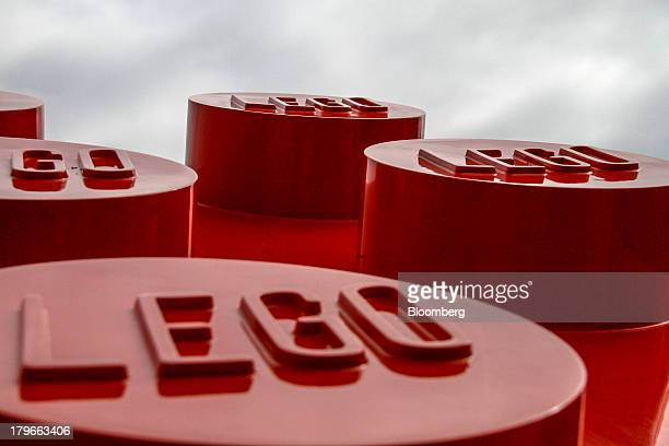 An artwork of oversized toy bricks stands on display outside the headquarters of Lego A/S in Billund Denmark on Thursday Sept 5 2013 Lego the Danish...