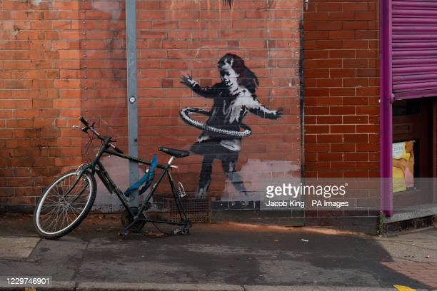 An artwork painted by Banksy on the side of a property at Rothesay Avenue and Ilkeston Road in Nottingham, which has had a replacement bicycle after...