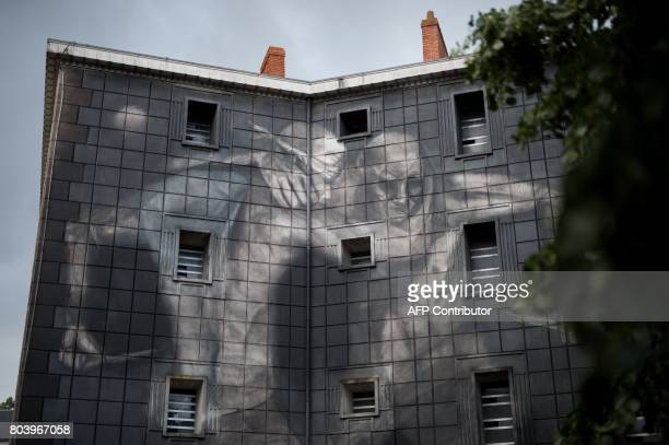 An artwork part of the installation entitled 'Entrez libre' by Pick Up Production is displayed on the facade of the former prison of Nantes on June...