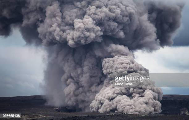 An ash plume rises from the Halemaumau crater within the Kilauea volcano summit caldera at the Hawaii Volcanoes National Park on May 9 2018 in Hawaii...