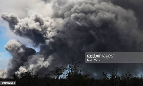 An ash plume rises in the distance from the Kilauea volcano on Hawaii's Big Island on May 15 2018 in Hawaii Volcanoes National Park Hawaii The US...