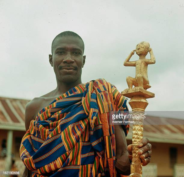 An Ashanti 'speaker' holding his staff of office a local adaptation of staffs introduced by European traders on the Gold Coast since the C 16th The...
