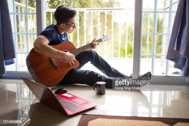an asia chinese businessman work from home. playing guitar during coffee break time. - songwriter stock pictures, royalty-free photos & images