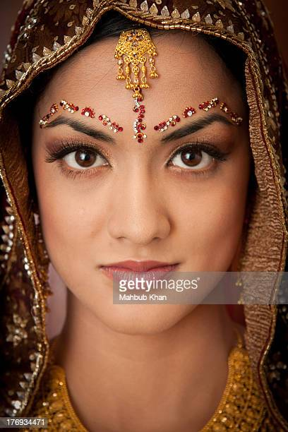 an asian bride headshot with jewellery - indian bride stock photos and pictures