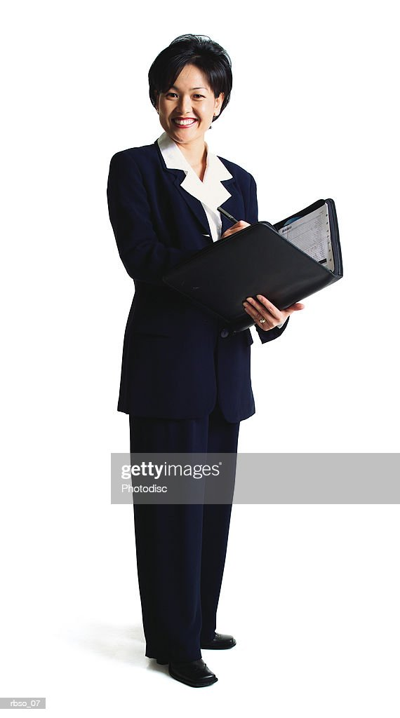 an asian business woman stands with her notebook planner and smiles : Foto de stock