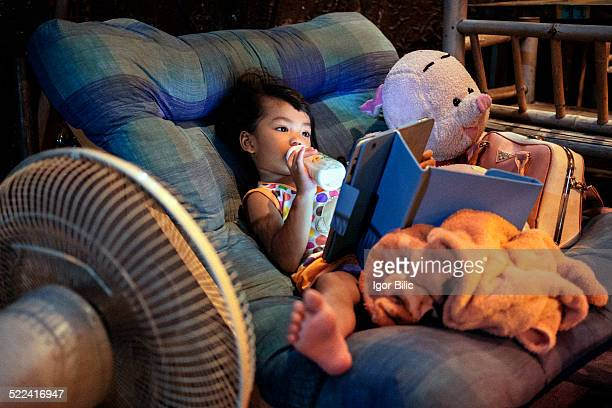 An Asian child using a digital tablet,