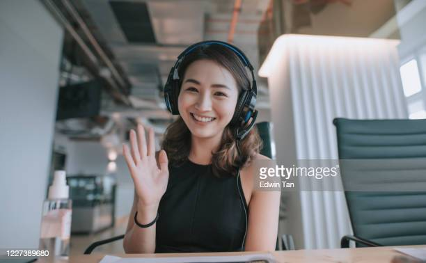 an asian chinese beautiful woman white collar worker talking to the camera video calling video conference with his business partners  with face mask - waving stock pictures, royalty-free photos & images