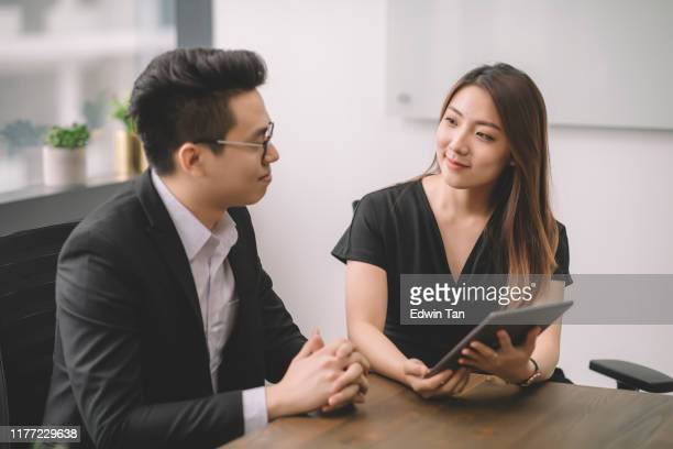an asian chinese female explaining to her client on the business proposal in the meeting room at office - asia stock pictures, royalty-free photos & images
