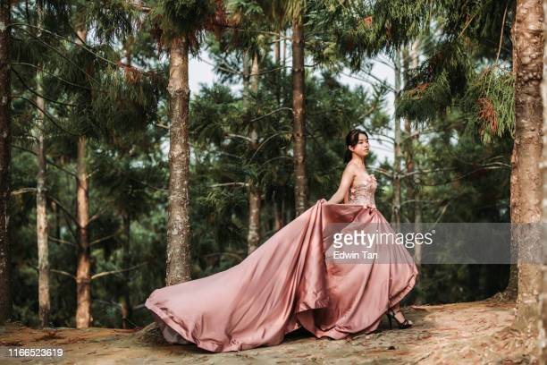 an asian chinese female model dress up with wedding gown for outdoor portrait session at public park in evening - forever young stock pictures, royalty-free photos & images