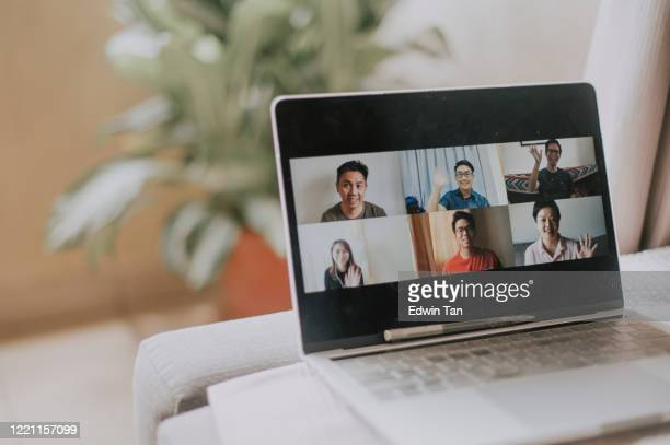 an asian chinese female working at home using laptop video conference call meeting - social gathering stock pictures, royalty-free photos & images