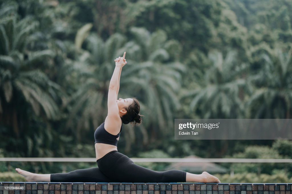 An Asian Chinese Female Yoga Instructor Demonstrating Yoga Poses High Res Stock Photo Getty Images