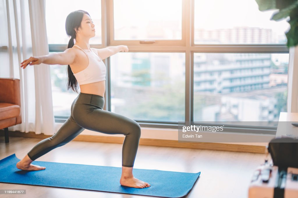 An Asian Chinese Teenage Girl Doing Yoga Posewarrior 2 In Her Living Room With Yoga Mat Morning Before She Goes To College High Res Stock Photo Getty Images