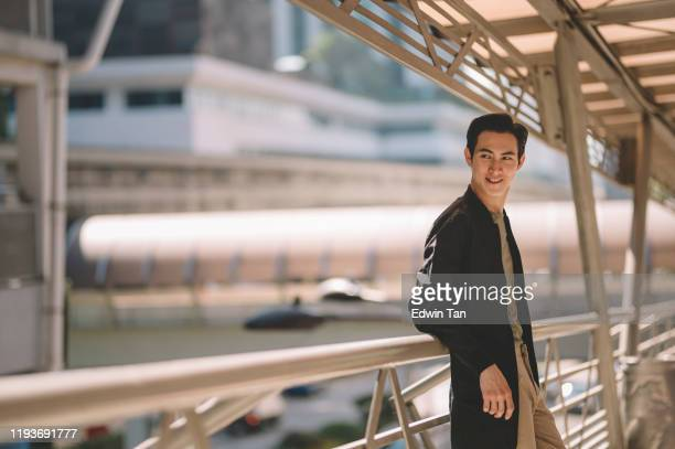 an asian chinese young man with his smart casual clothing with jacket at the street of city at the bridge - smart casual stock pictures, royalty-free photos & images