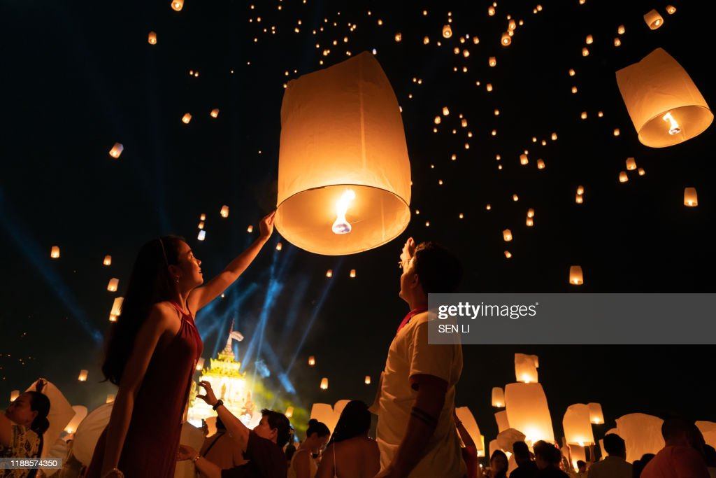 An Asian Couple Who Is Going To Release A Lantern During Chiang Mai Lantern Festival High Res Stock Photo Getty Images