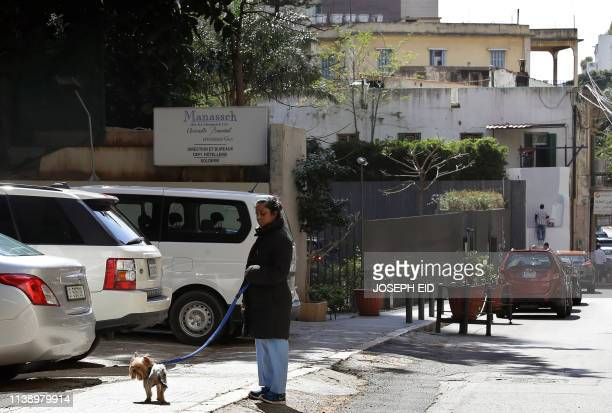 An Asian domestic worker walks her employer's dog in the Lebanese capital of Beirut on April 22 2019 Amnesty International on April 23 urged Lebanon...