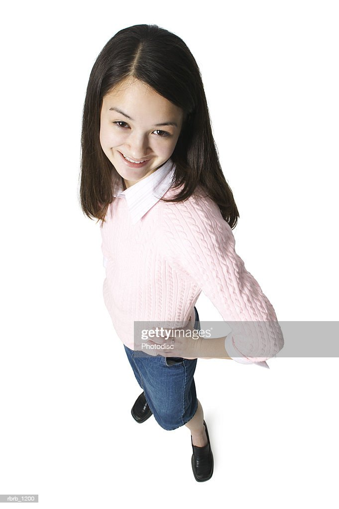 An Asian Female Teen In A Jean Skirt And A Pink Sweater Smiles Up At The